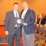 FDLE Bureau Chief Glen Hopkins presents perfect audit award to MTC Law Enforcement Academy director Jay Romine